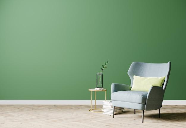 Salone moderno luminoso vuoto con poltrona blu e tavolino con decorazione sulla parete verde vuota