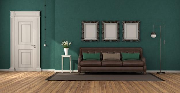 Salotto classico verde con divano in pelle