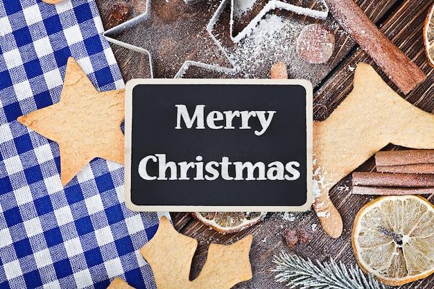Saluti buon natale e accessori per biscotti da forno