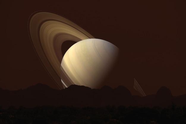 Saturno indietro la montagna della siluetta sulla nuvola e sul cielo notturno