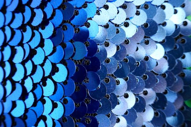 Scaglie di trama di tessuto sfumato verde blu brillante con paillettes