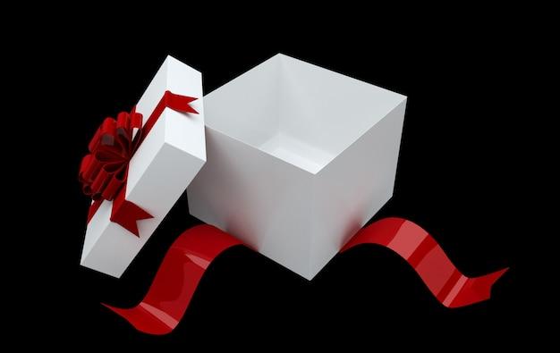 Scatola regalo bianca con fiocco rosso e coriandoli isolato su sfondo nero. confezione regalo sorpresa