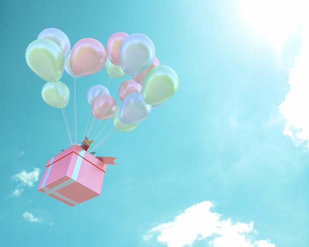 Scatola regalo rosa e palloncini colore pastello in cielo