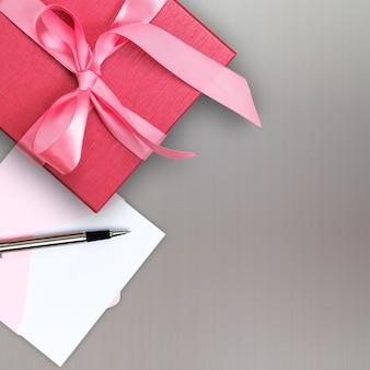 Scatola regalo rosso con biglietto di auguri
