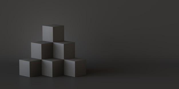 Scatole di cubo nero con sfondo muro scuro