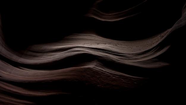 Scenario mozzafiato di belle trame di sabbia al buio in antelope canyon, usa
