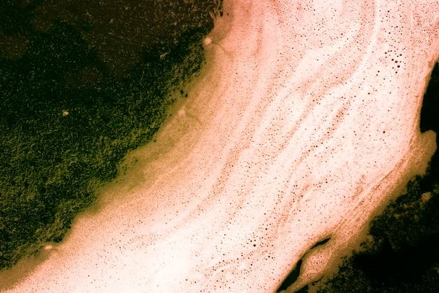 Schiuma e bolle su liquido verde