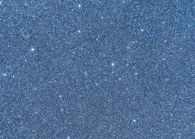Scintille blu e sfondo di luci bianche