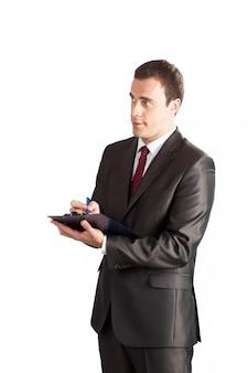 Scrittura riuscita dell'uomo d'affari in lavagna per appunti