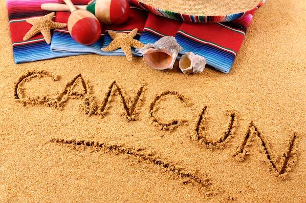 Scrittura sulla spiaggia di cancun
