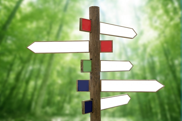 Segni di freccia direzionale in legno crossroad
