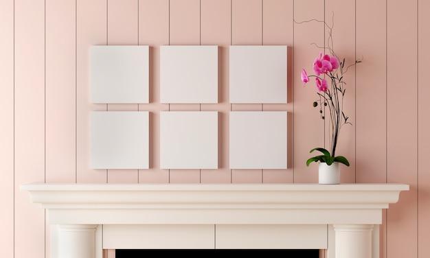 Sei cornici vuote su una parete di legno rosa pastello hanno un vaso di fiori posto sul camino.