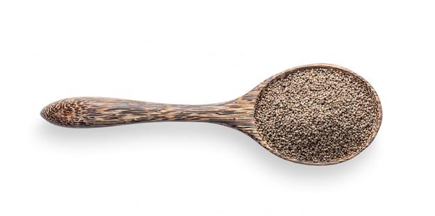 Seme di erbe del perilla in cucchiaio di legno isolato