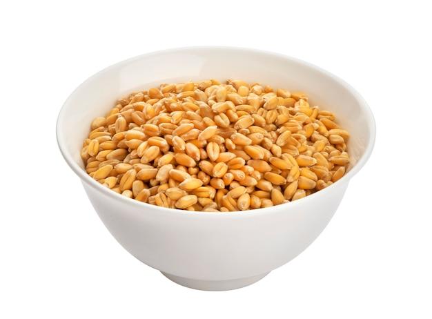 Semi del grano isolati su bianco con il percorso di ritaglio