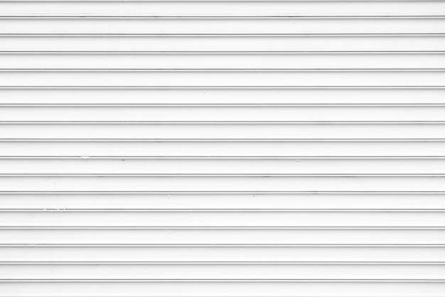 Semplice muro di metallo bianco sullo sfondo