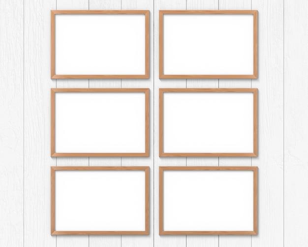 Set di 6 mockup di cornici orizzontali in legno appese al muro