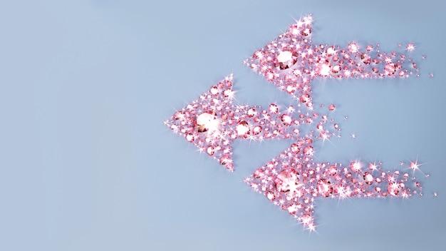 Set di gioielli sparsi su una superficie a forma di tre frecce. illustrazione 3d