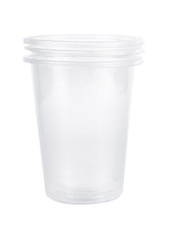 Set di vetro di plastica isolato su superficie bianca
