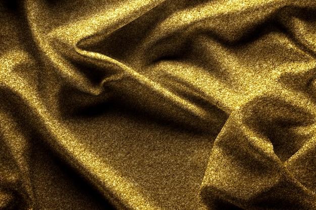 Seta di tessuto d'oro con trama glitter per lo sfondo.