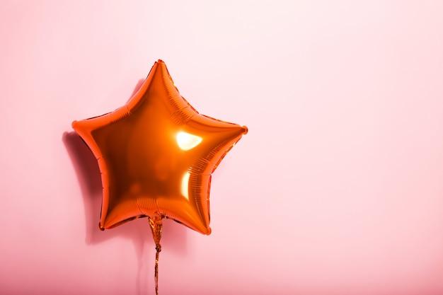 Sfera a stella sul rosa
