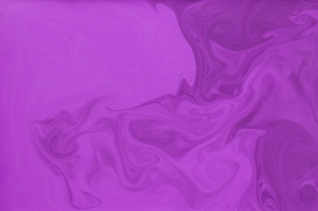 Sfondo astratto con l'arte della vernice rosa