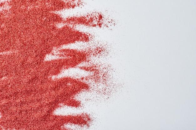 Sfondo astratto con la trama glitter rosso