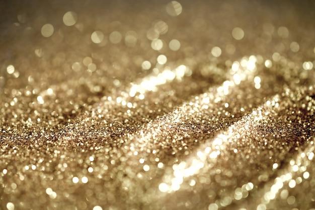Sfondo astratto con texture glitter oro ed elegante