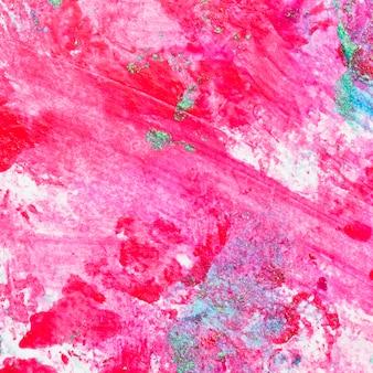 Sfondo astratto dello smalto rosa con schizzi