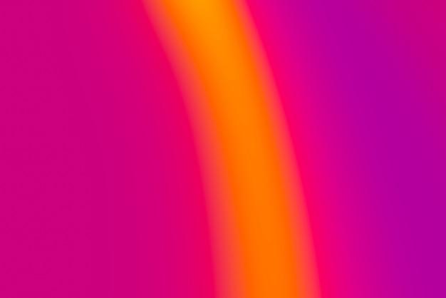 Sfondo astratto pop sfocato con colori caldi - viola, arancione. rosa e giallo
