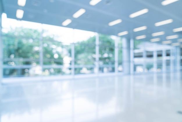 Sfondo astratto sfocato sfondo vista interna guardando verso vuoto ufficio hall e porte d'ingresso e parete di vetro con telaio