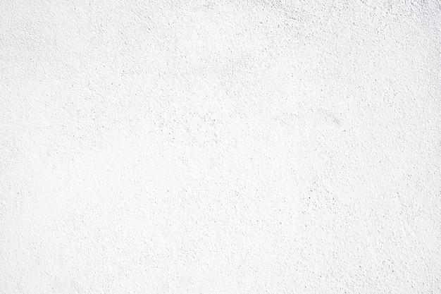 Sfondo bianco cemento. grossa parete di fondo imbiancata. costruzione a trama ruvida