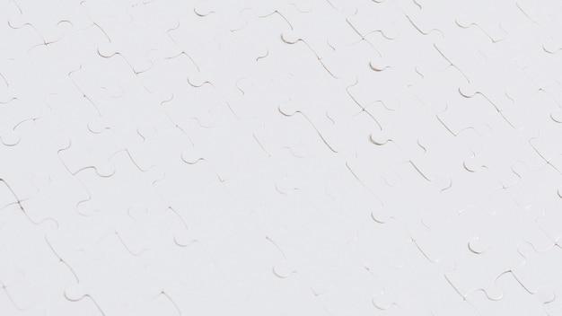 Sfondo bianco puzzle. vista dall'alto.
