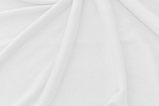 Sfondo bianco trama del tessuto. superficie astratta della tela dell'onda.