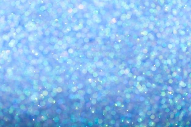 Sfondo blu lucido sfocato con luci scintillanti.