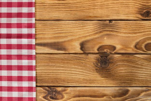 Sfondo con tavolo in legno vuota con tovaglia