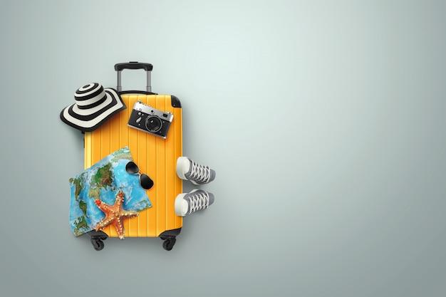 Sfondo creativo, valigia gialla, scarpe da ginnastica, mappa su uno sfondo grigio