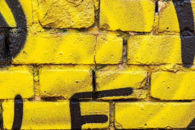 Sfondo del muro di mattoni gialli