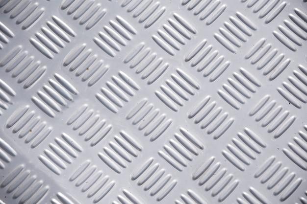 Sfondo del piatto diamantato in metallo. struttura metallica senza soluzione di continuità, tabella di lamiera di acciaio.