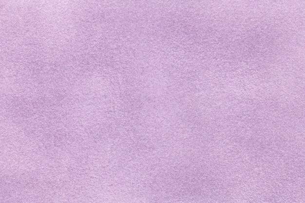 Sfondo del primo piano tessuto viola scamosciato.