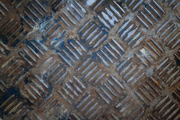 Sfondo del vecchio piatto diamantato in metallo