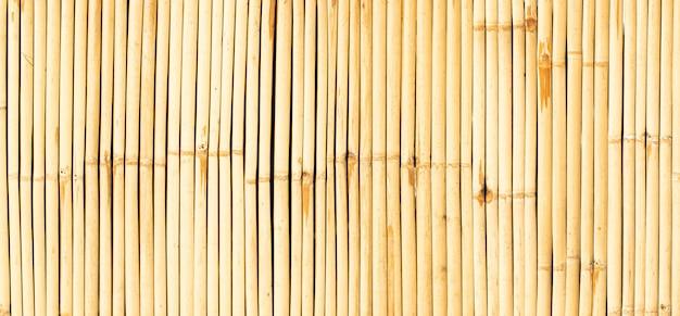 Sfondo di bambù giallo muro.