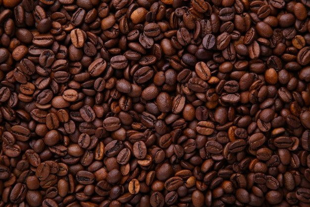Sfondo di chicchi di caffè aroma. close up caffè.