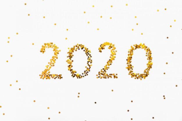 Sfondo di coriandoli a forma di stella dorata nuovo anno 2020.
