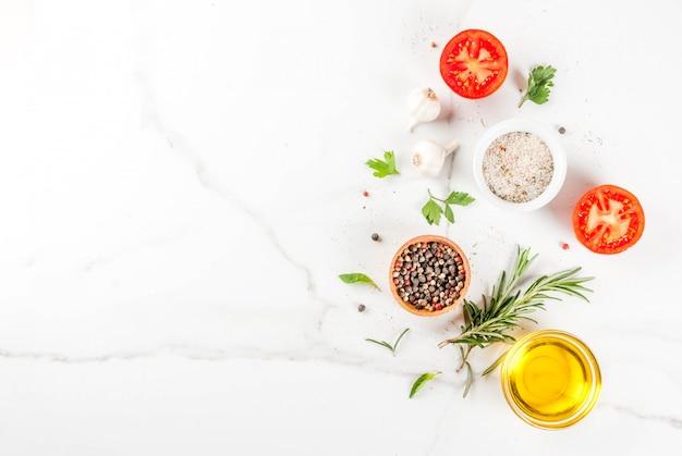 Sfondo di cottura, erbe aromatiche, sale, spezie, olio d'oliva