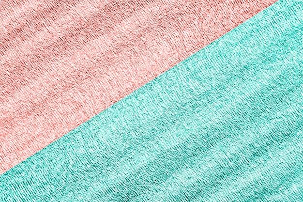 Sfondo di due colori menta e rosa con superficie stropicciata lucida per sfondo texture.