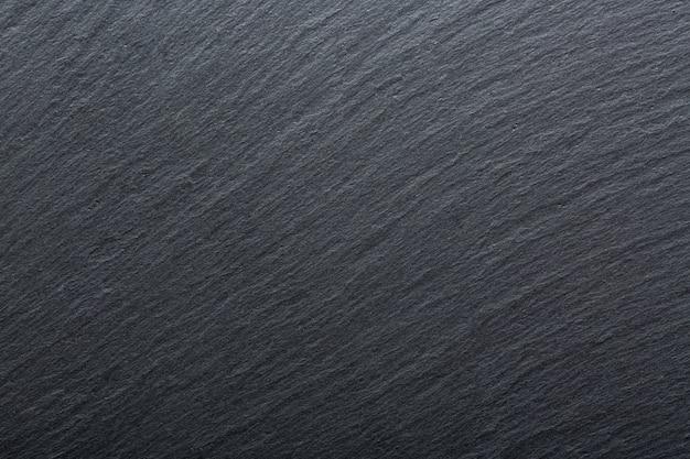 Sfondo di granito ardesia grigio scuro e nero.