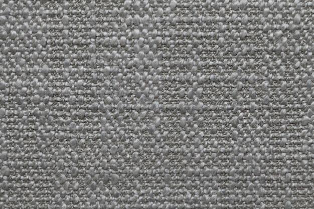 Sfondo di lana a maglia grigia con un motivo di morbido