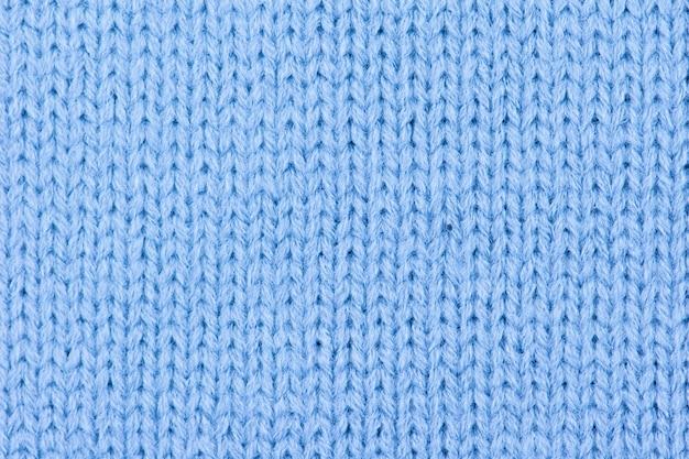 Sfondo di lana blu a maglia.