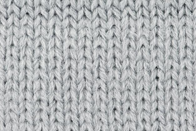 Sfondo di lana grigia a maglia.