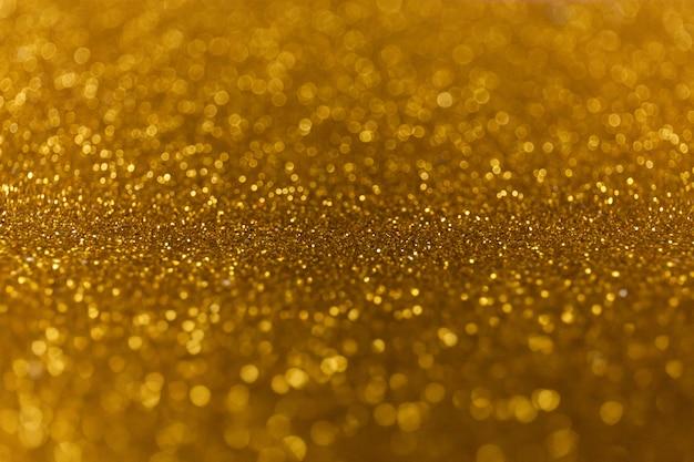 Sfondo di luci brillanti glitter astratto. luci sfocate